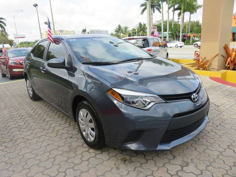 2015 TOYOTA COROLLA LE 4DR SEDAN gray the showroom miami is a family owned first class used car