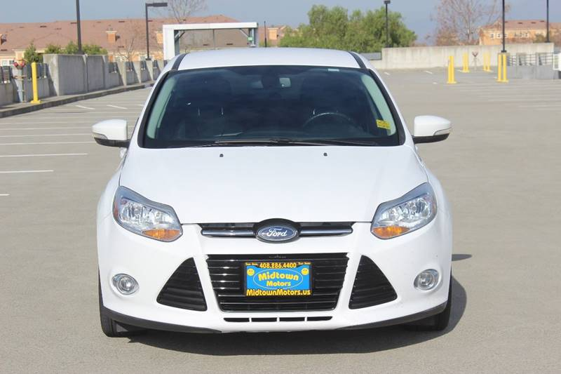 2012 FORD FOCUS SEL 4DR HATCHBACK white rear spoiler - roofline body side moldings - chrome doo