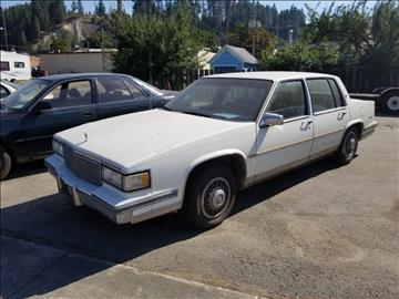 1987 Cadillac DeVille for sale at Riverside Auto Center in Bonners Ferry ID