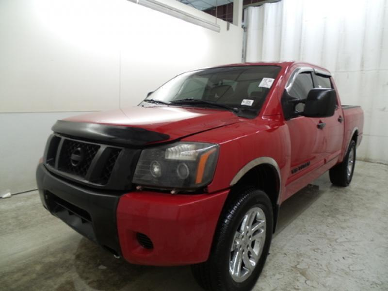 2010 Nissan Titan for sale at Riverside Auto Center in Bonners Ferry ID