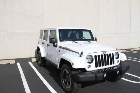 2014 Jeep Wrangler Unlimited for sale at Misar Motors in Ada MI