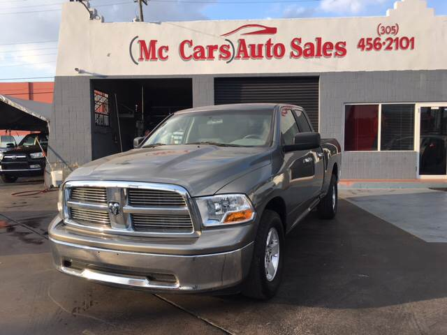 2012 RAM RAM PICKUP 1500 SLT 4X2 4DR QUAD CAB 63 FT SB gray 2-stage unlocking doors abs - 4-wh