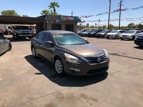 2013 Nissan Altima for sale at Valley Auto Center in Phoenix AZ