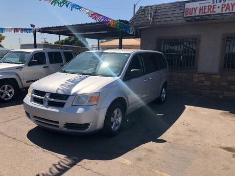 2010 Dodge Grand Caravan for sale at Valley Auto Center in Phoenix AZ