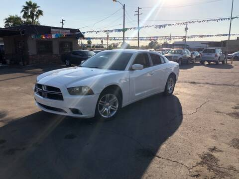 2011 Dodge Charger for sale at Valley Auto Center in Phoenix AZ