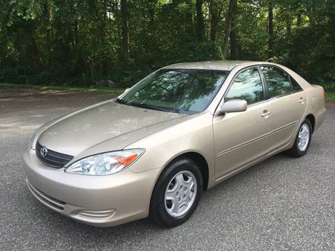 2002 Toyota Camry for sale at Lou Rivers Used Cars in Palmer MA