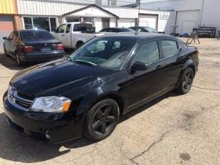 2013 Dodge Avenger for sale at RABI AUTO SALES LLC in Garden City ID