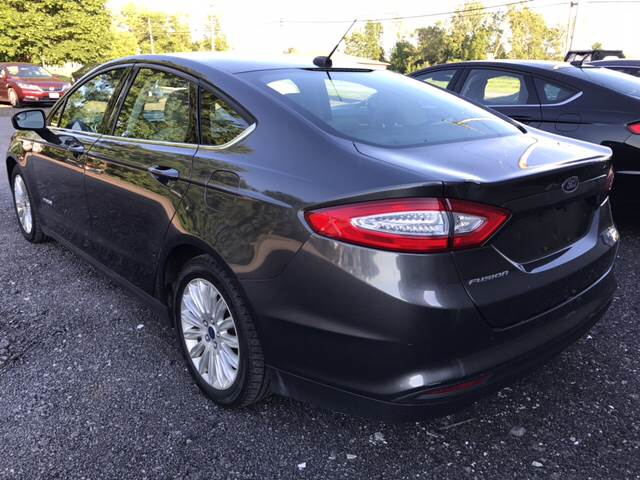 2015 Ford Fusion Hybrid for sale at CERTIFIED AUTO SALES in Le Roy NY