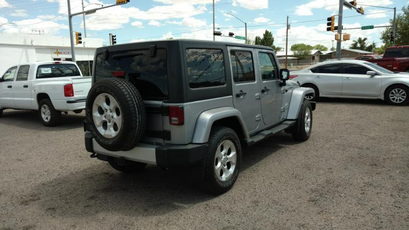 2014 Jeep Wrangler Unlimited for sale at AUGE'S SALES AND SERVICE in Belen NM