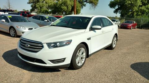2014 Ford Taurus for sale at AUGE'S SALES AND SERVICE in Belen NM