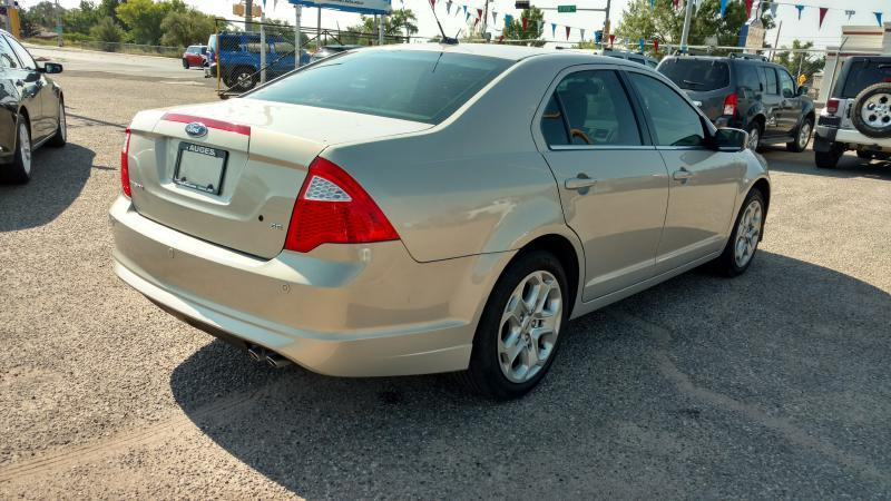 2010 Ford Fusion for sale at AUGE'S SALES AND SERVICE in Belen NM