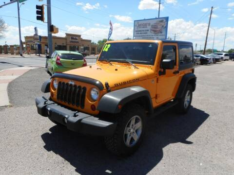 2012 Jeep Wrangler for sale at AUGE'S SALES AND SERVICE in Belen NM