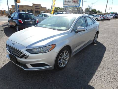 2017 Ford Fusion Hybrid for sale at AUGE'S SALES AND SERVICE in Belen NM