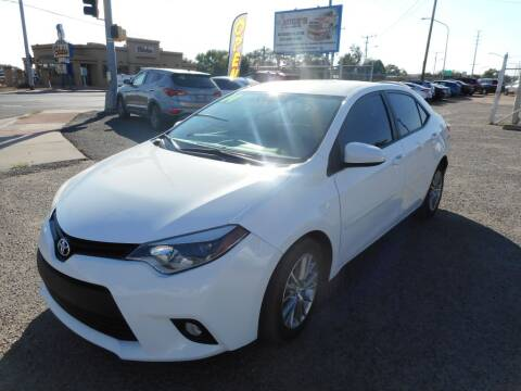 2014 Toyota Corolla for sale at AUGE'S SALES AND SERVICE in Belen NM