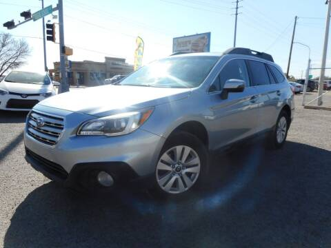 2015 Subaru Outback for sale at AUGE'S SALES AND SERVICE in Belen NM