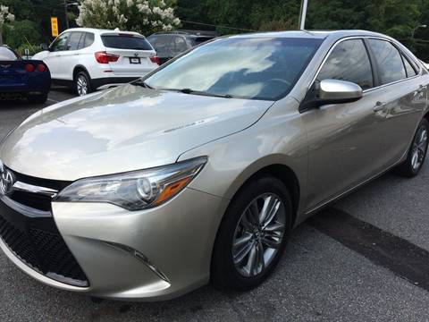 2015 Toyota Camry for sale at Highlands Luxury Cars, Inc. in Marietta GA
