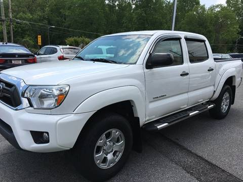 2015 Toyota Tacoma for sale at Highlands Luxury Cars, Inc. in Marietta GA