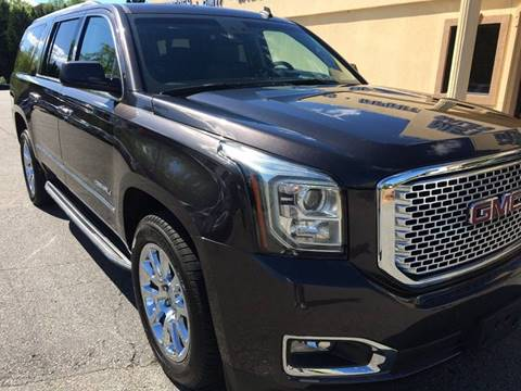 2015 GMC Yukon XL for sale at Highlands Luxury Cars, Inc. in Marietta GA