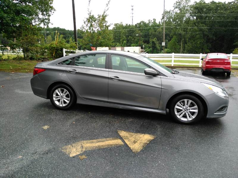 2014 Hyundai Sonata for sale at Auto Source  LLC in Acworth GA