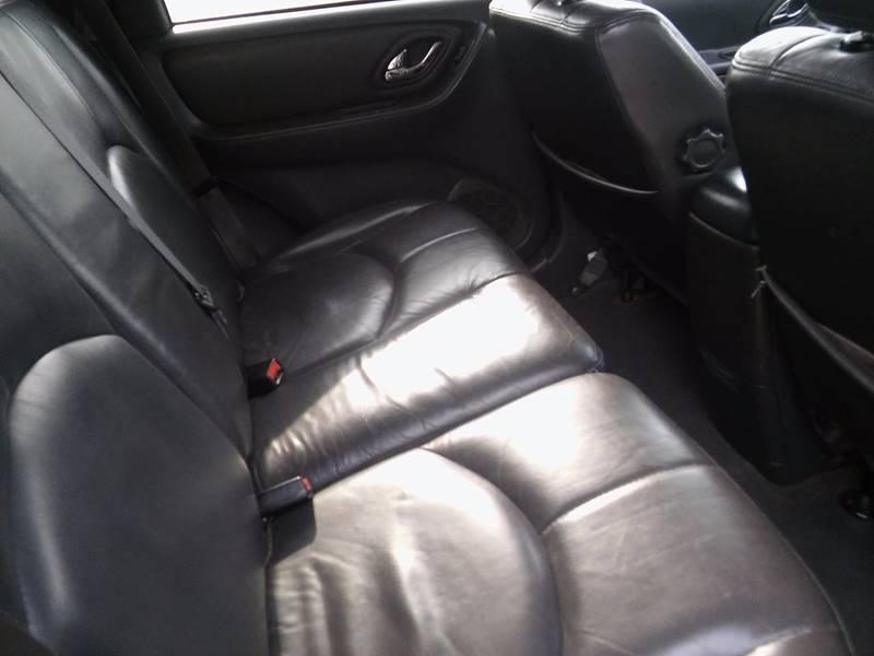 2005 Mazda Tribute for sale at Revolution Motors LLC in Wentzville MO