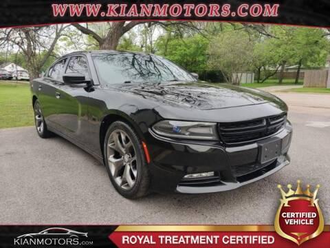 2015 Dodge Charger SXT for sale at KIAN MOTORS INC in Denton TX