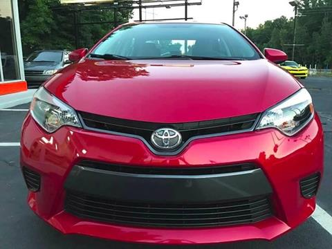 2016 Toyota Corolla for sale at Monmars Auto Club in Tampa FL