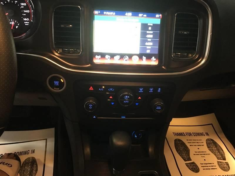 2014 Dodge Charger for sale at Monmars Auto Club in Tampa FL