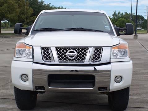 2011 Nissan Titan for sale at CAR HERO LLC in Houston TX