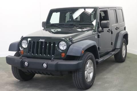 2011 Jeep Wrangler Unlimited for sale at Clawson Auto Sales in Clawson MI