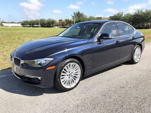 2015 BMW 3 Series for sale at DENMARK AUTO BROKERS in Riviera Beach FL