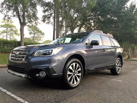 2015 Subaru Outback for sale at DENMARK AUTO BROKERS in Riviera Beach FL