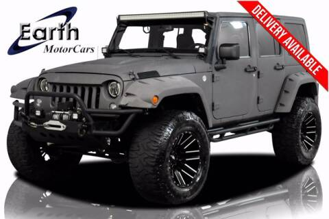 2014 Jeep Wrangler Unlimited for sale at EARTH MOTOR CARS in Carrollton TX