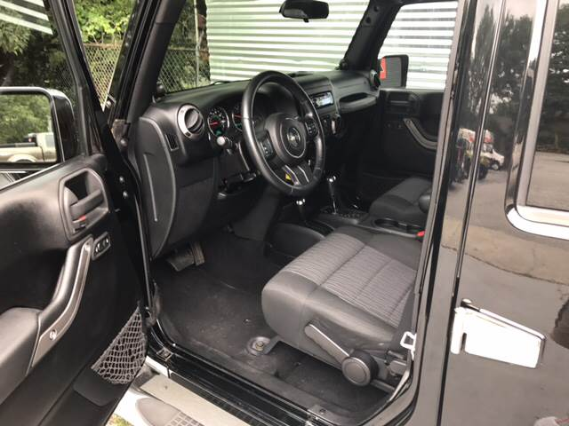 2011 Jeep Wrangler Unlimited for sale at IRONWORKS MOTORSPORTS in Cartersville GA