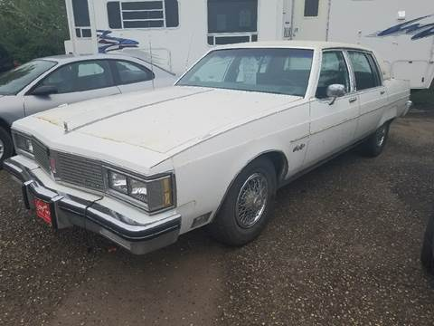 1983 Oldsmobile Ninety-Eight for sale at BARNES AUTO SALES in Mandan ND