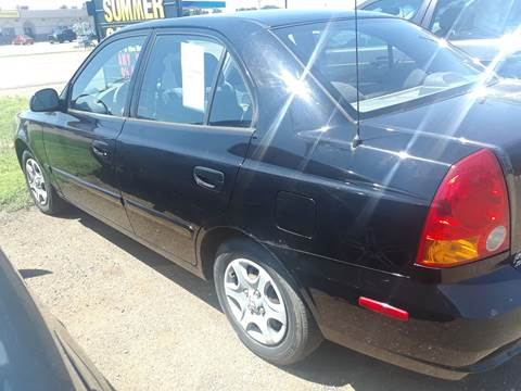 2004 Hyundai Accent for sale at BARNES AUTO SALES in Mandan ND