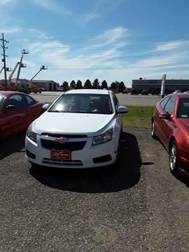2011 Chevrolet Cruze for sale at BARNES AUTO SALES in Mandan ND