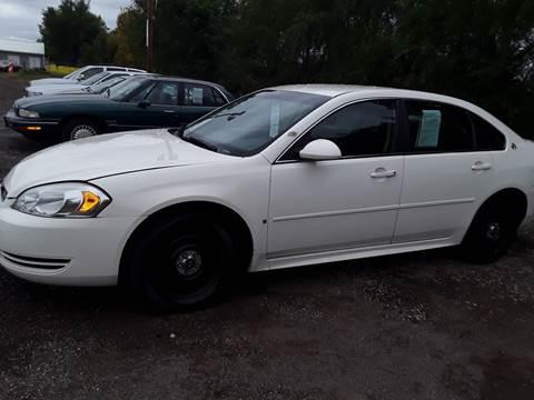 2009 Chevrolet Impala for sale at BARNES AUTO SALES in Mandan ND