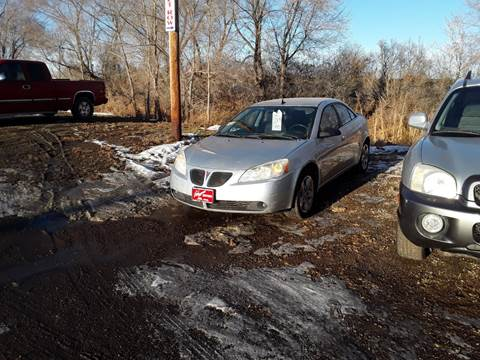 2009 Pontiac G6 for sale at BARNES AUTO SALES in Mandan ND