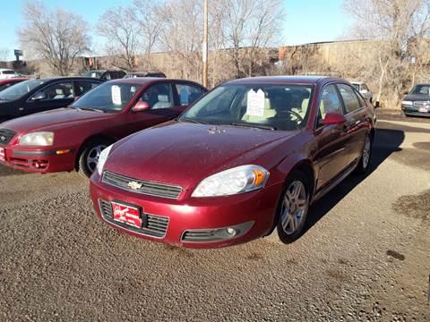2011 Chevrolet Impala for sale at BARNES AUTO SALES in Mandan ND