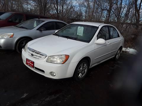 2005 Kia Spectra for sale at BARNES AUTO SALES in Mandan ND