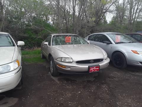 1995 Buick Riviera for sale at BARNES AUTO SALES in Mandan ND
