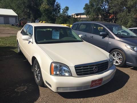 2003 Cadillac DeVille for sale at BARNES AUTO SALES in Mandan ND