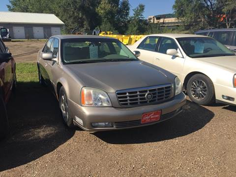 2001 Cadillac DeVille for sale at BARNES AUTO SALES in Mandan ND