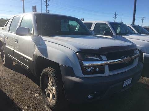 2003 Chevrolet Avalanche for sale at BARNES AUTO SALES in Mandan ND