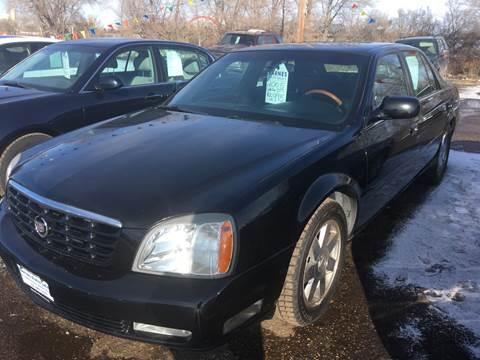 2005 Cadillac DeVille for sale at BARNES AUTO SALES in Mandan ND