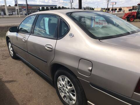 2003 Chevrolet Impala for sale at BARNES AUTO SALES in Mandan ND