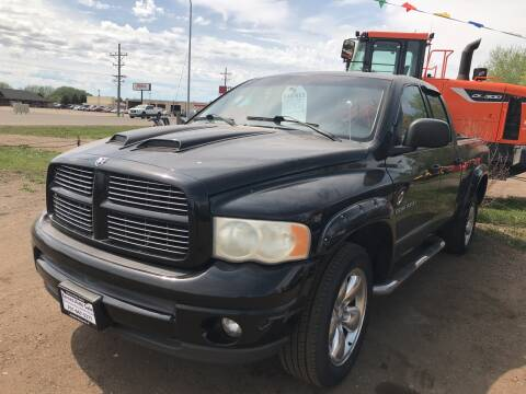 2002 Dodge Ram Pickup 1500 for sale at BARNES AUTO SALES in Mandan ND