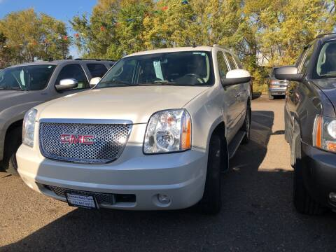 2009 GMC Yukon for sale at BARNES AUTO SALES in Mandan ND
