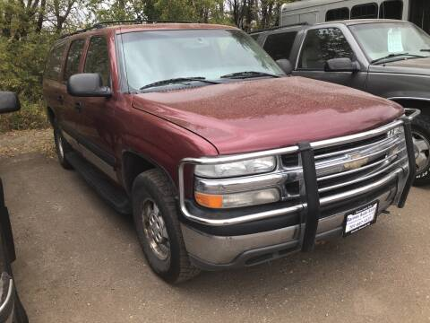 2003 Chevrolet Suburban for sale at BARNES AUTO SALES in Mandan ND