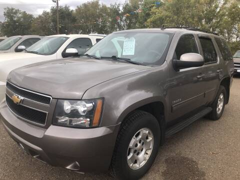 2013 Chevrolet Tahoe for sale at BARNES AUTO SALES in Mandan ND